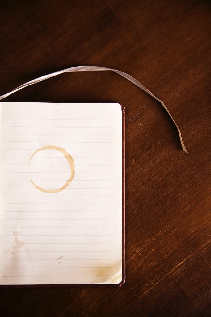 Blank piece of paper with coffee ring stain. OER adoption can replace traditional textbooks.