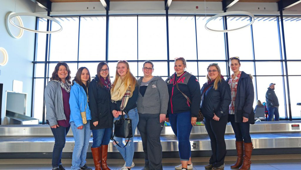 Six ACC students and two teachers standing together at the 'Women in Ag' Conference