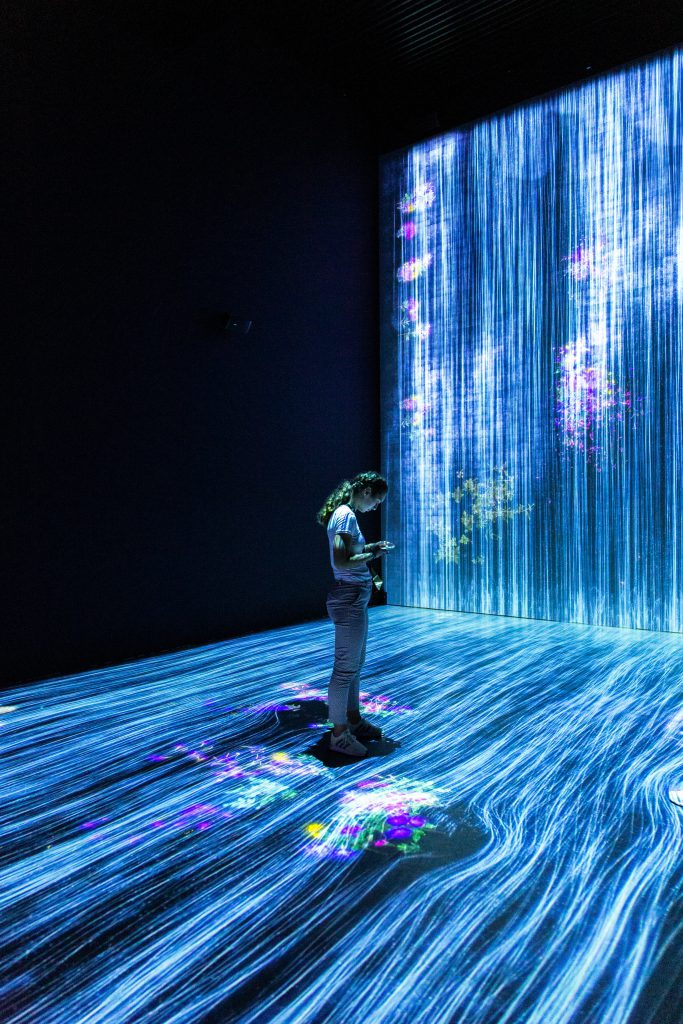 Young woman in an interactive environment.